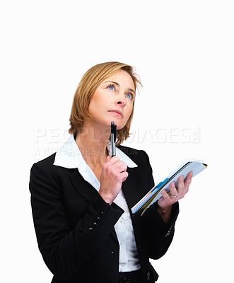 Buy stock photo Portrait of mature female lawyer holding a writing pad and thinking while looking up at copyspace