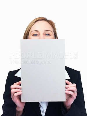 Buy stock photo Portrait of middle aged businesswoman peeping over blank billboard isolated over white background