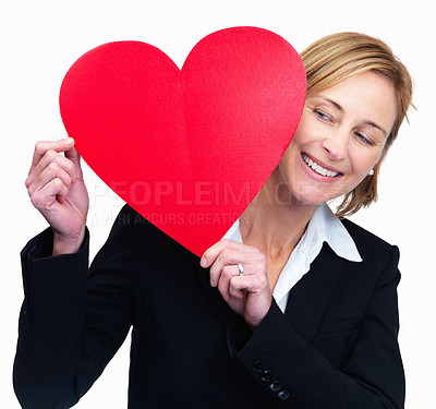 Buy stock photo Happy woman looking at the heart in hand on white background