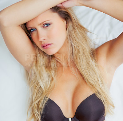 Buy stock photo Portrait of a sexy young woman in a black brassiere