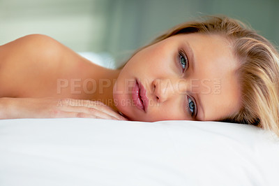 Buy stock photo Portrait of a sensuous young woman lying on bed at home