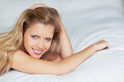 Buy stock photo Attractive young woman smiling on bed with copyspace