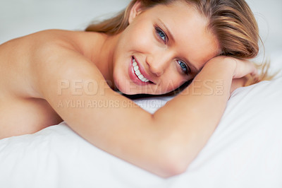 Buy stock photo Portrait of a naked smiling sexy female lying on bed