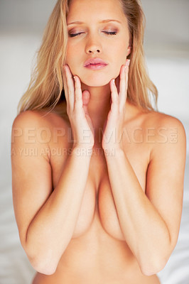 Buy stock photo Portrait of a sexy young naked model covering her breast with eyes closed