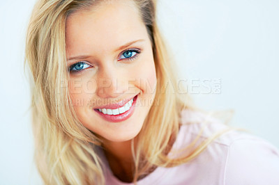 Buy stock photo Closeup portrait of a pretty blond with blue eyes smiling