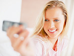 Self photography - An attractive blond with a cellphone