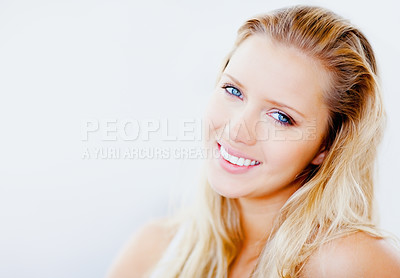 Buy stock photo Closeup portrait of a pretty young female smiling against white