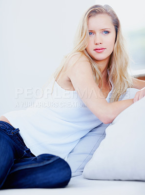 Buy stock photo Portrait of a relaxed young female sitting on a couch