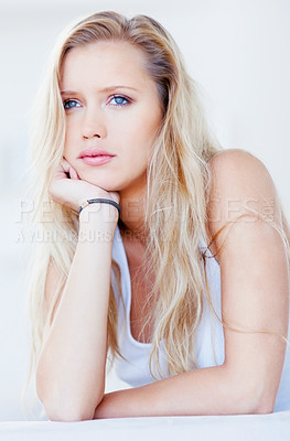 Buy stock photo Relaxed and thoughtful young female looking away