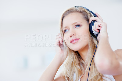 Buy stock photo Pretty fresh woman listening to music with headphones - copyspace