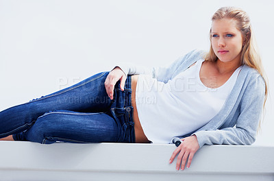 Buy stock photo Portrait of a casual and sexy woman lying on pose against white