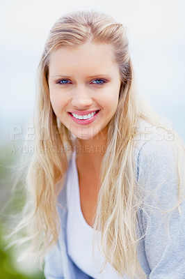 Buy stock photo Pretty young Caucasian woman smiling outdoors