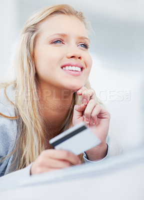 Buy stock photo Cute happy young woman shopping online with a credit card