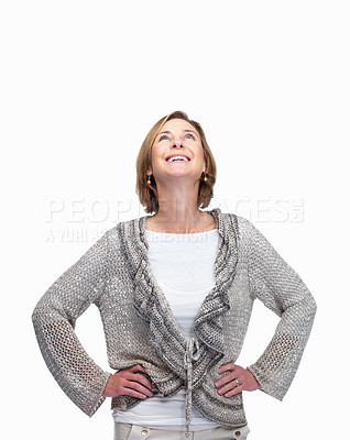 Buy stock photo Portrait of beautiful mature woman looking upwards and smiling over white background