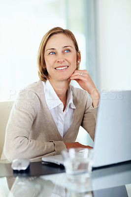 Buy stock photo Portrait of happy middle aged businesswoman lost in thought while at work