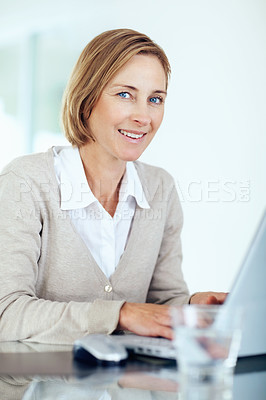 Buy stock photo Portrait of beautiful middle aged businesswoman working on laptop - Indoors