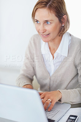 Buy stock photo Closeup portrait of happy mature businesswoman using laptop