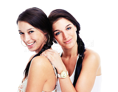 Buy stock photo Two beautiful young women posing for an affectionate picture, isolated on white - copyspace