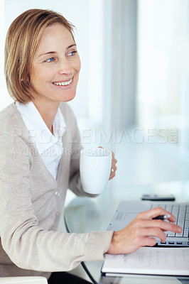 Buy stock photo Portrait of mature businesswoman looking at something interesting while working at her desk