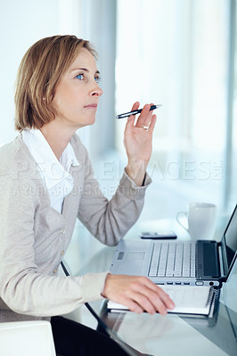 Buy stock photo Portrait of middle aged businesswoman thinking while at work