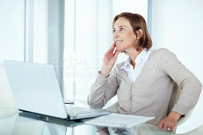 Buy stock photo Portrait of an attractive mature businesswoman daydreaming while sitting in office
