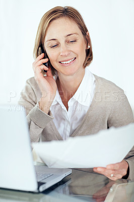 Buy stock photo Portrait of lovely lady reading the documents while talking on mobile