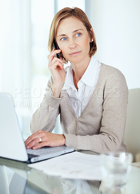 Buy stock photo Portrait of middle aged businesswoman thinking while talking on mobile