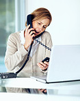 Businesswoman handling different phone calls at office