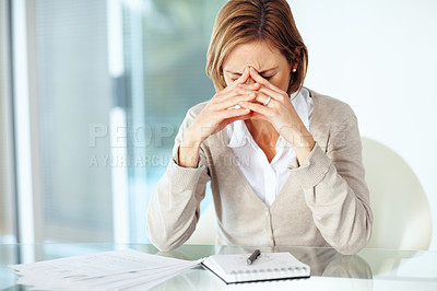 Buy stock photo Portrait of mature disappointed businesswoman sitting at desk in office