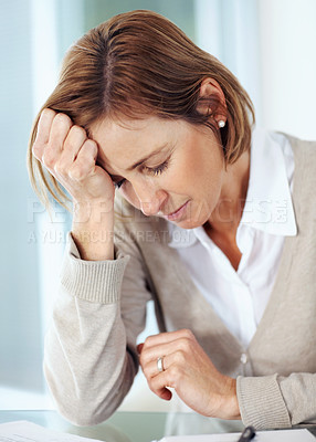 Buy stock photo Portrait of tensed mature businesswoman sitting at desk