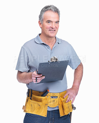 Buy stock photo Portrait of a mature handyman with a notepad isolated against white background