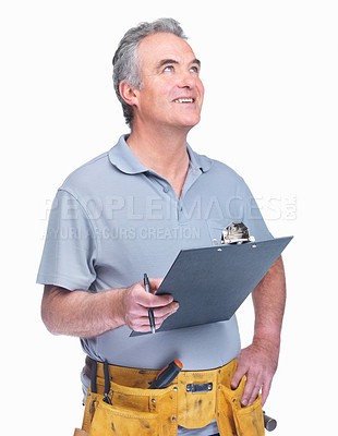 Buy stock photo Portrait of a mature handyman with a notepad looking up on white background