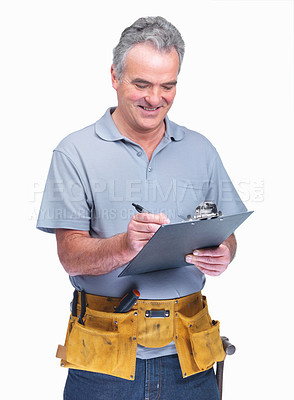 Buy stock photo Happy mature man writing over the notepad against white background