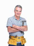 Happy mature handyman wearing a tool belt with hammer in hand