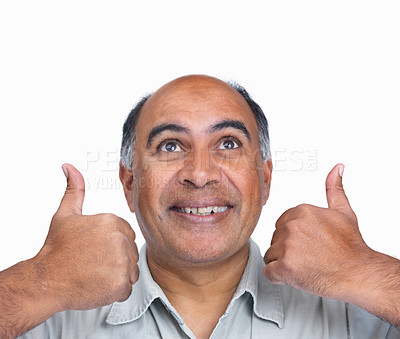 Buy stock photo Closeup portrait of a smiling mature man gesturing a thumbs up sign against white