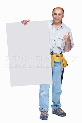 Buy stock photo Full length of a middle aged carpenter with a blank billboard on white and gesturing a success sign