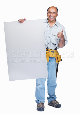 Buy stock photo Full length of a mature handyman with an empty billboard on white and gesturing a success sign