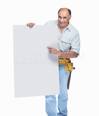 Buy stock photo Smiling middle aged carpenter pointing at an empty billboard isolated on white