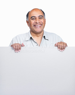 Buy stock photo Happy middle aged man holding a blank billboard isolated on white