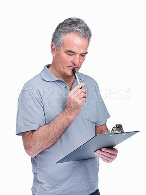Buy stock photo Portrait of a thoughtful elderly man using a notepad isolated on white