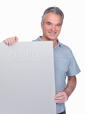 Buy stock photo Portrait of a happy senior man holding an empty billboard isolated on white