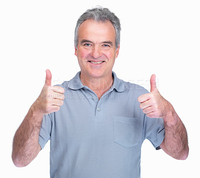 Buy stock photo Portrait of a senior man gesturing a thumbs up sign with both hands over white background
