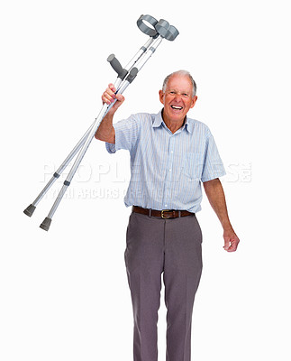 Buy stock photo Happy senior man holding his crutches isolated against white background