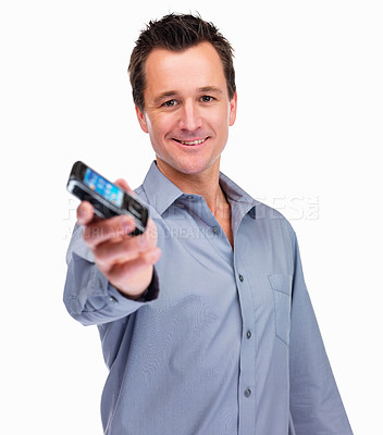 Buy stock photo Handsome happy mature guy holding a new cell phone isolated on white background
