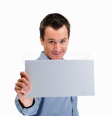 Buy stock photo Confident mature man holding blank billboard against white background
