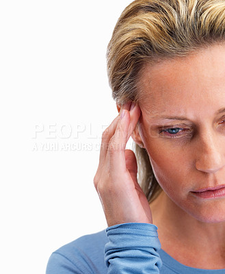 Buy stock photo Cropped image of a mature woman holding her head on white background