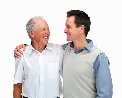 Buy stock photo Portrait of a father and son looking at eachother against white background