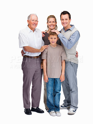 Buy stock photo Portrait of a happy family of four standing together against white background