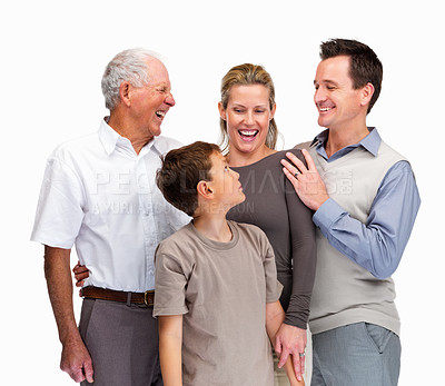 Buy stock photo Portrait of a happy family of four smiling together against white background
