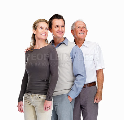 Buy stock photo Portrait of a happy family looking upwards against white background